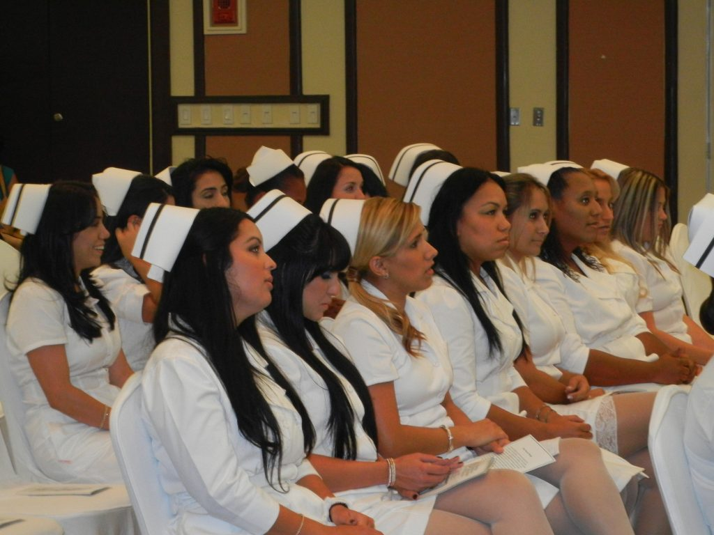 Nursing graduates waiting for their nursing pins
