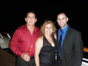 Florida National University graduate Yusnier Gutierrez with his parents