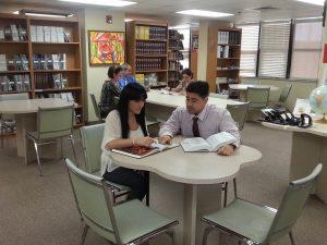 FNU tutor helping a student