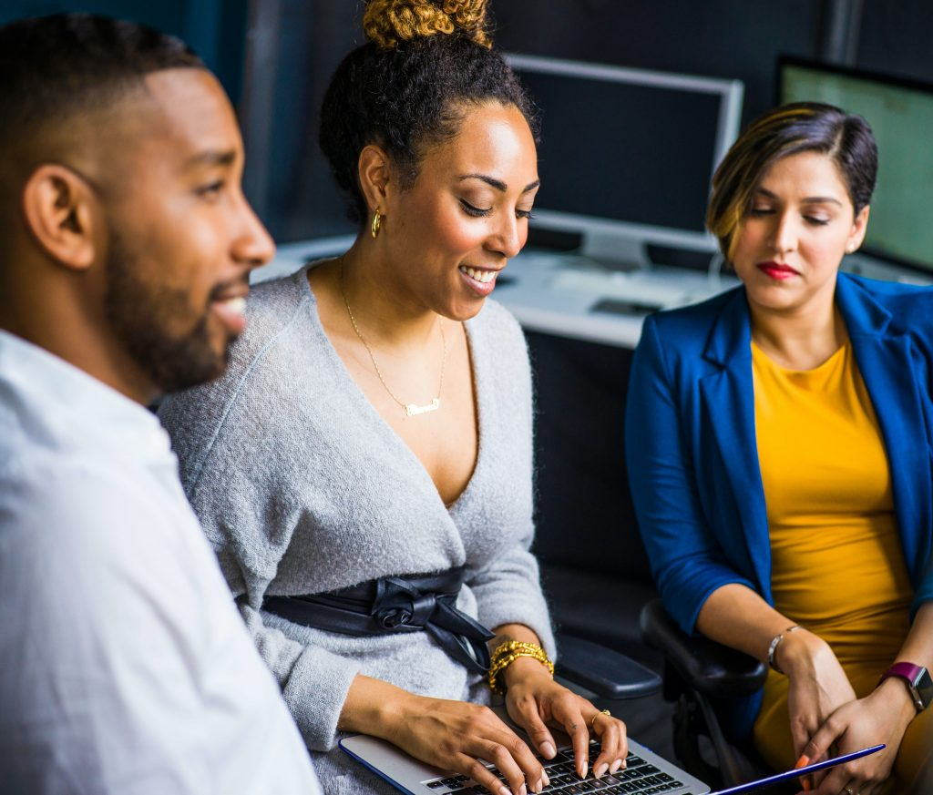 Man and two women sitting down looking at a computer. How to Choose the Right Career for You
