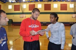 Coach teaching players