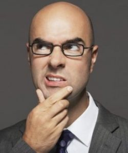 Confused man scratching his chin looking upwards