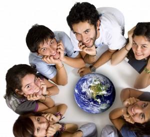 students huddled around globe