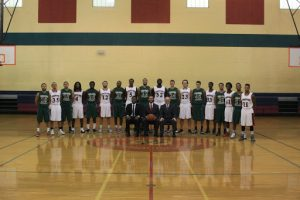 FNU PR for basketball team, team and coaches posing on court