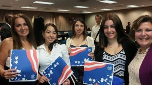 FNU students holding American flag posters