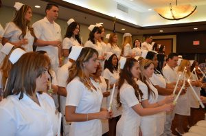 Florida National University Nursing Program Posing for award