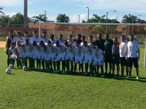 FNU men soccer team posing with coaches