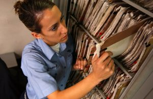 Medical assistant putting away documents
