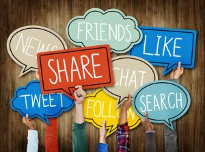 "Hands holding the words ""Share, Friends, Like, Search, Tweet, Follow, News, Chat"""