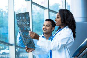 Doctors looking at MRI results