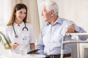 Nurse having conversation with senior citizen