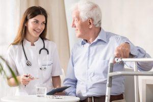 Nurse having conversation with senior citizen