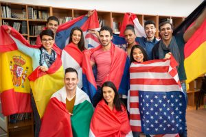 Students wearing different country flags