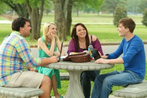 A group of students having a conversation outside