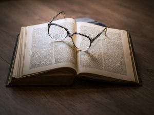 Glasses on top of open book