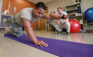 Physical therapist helping soldier