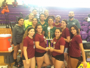 FNU Vollyeball Team holding up championship trophy