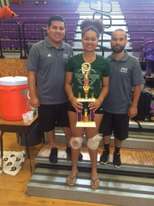 Silvia Galeano and coaches hold up championship trophy
