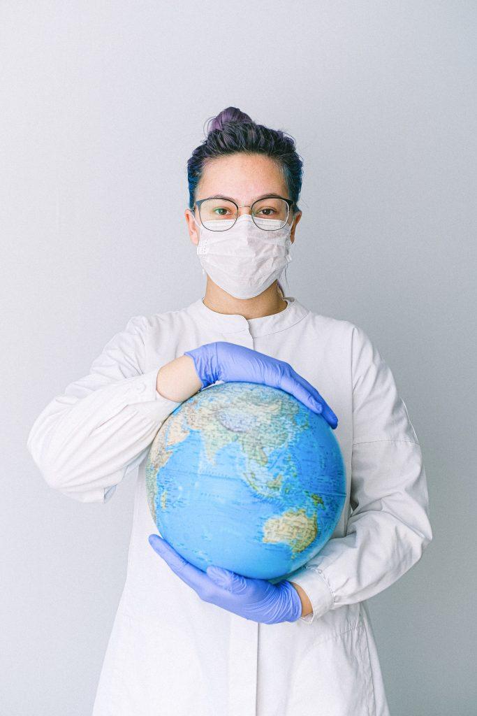 Nurse holding a globe. travel nurse