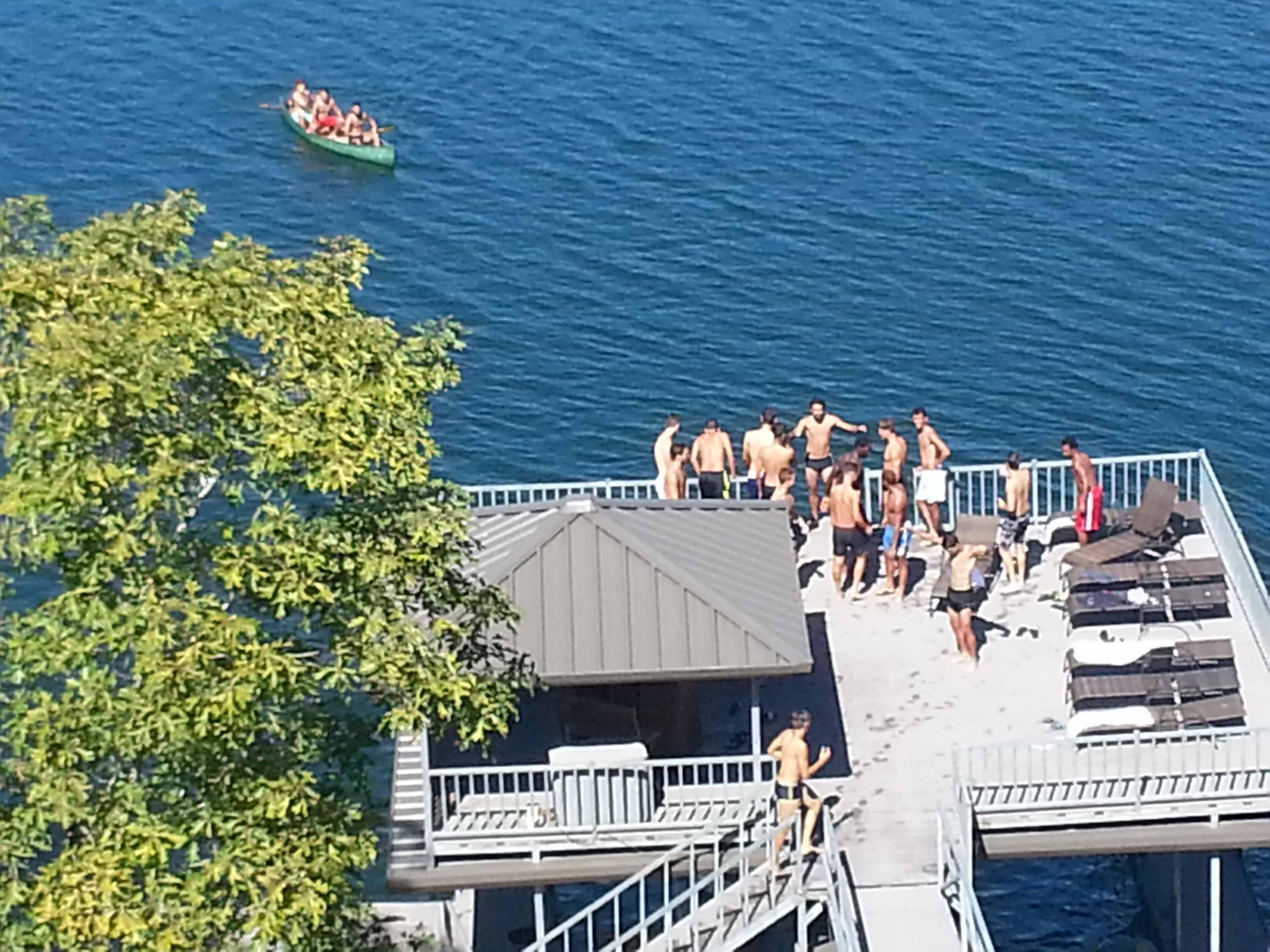 Men's Soccer having fun on double decker dock on Smith Lake