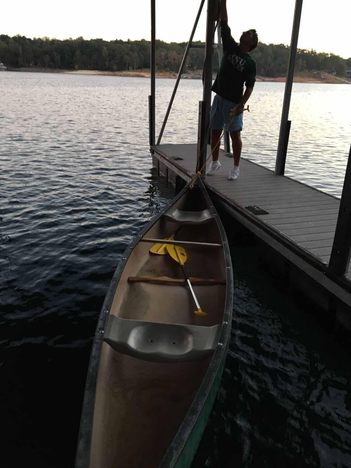 Coach Fernando getting canoe ready