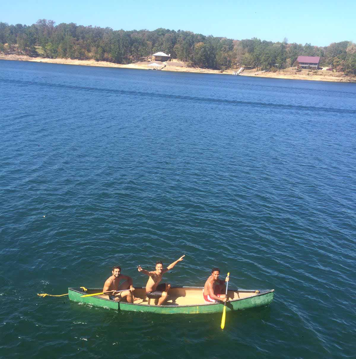 Men's Soccer on canoe in Smith Lake