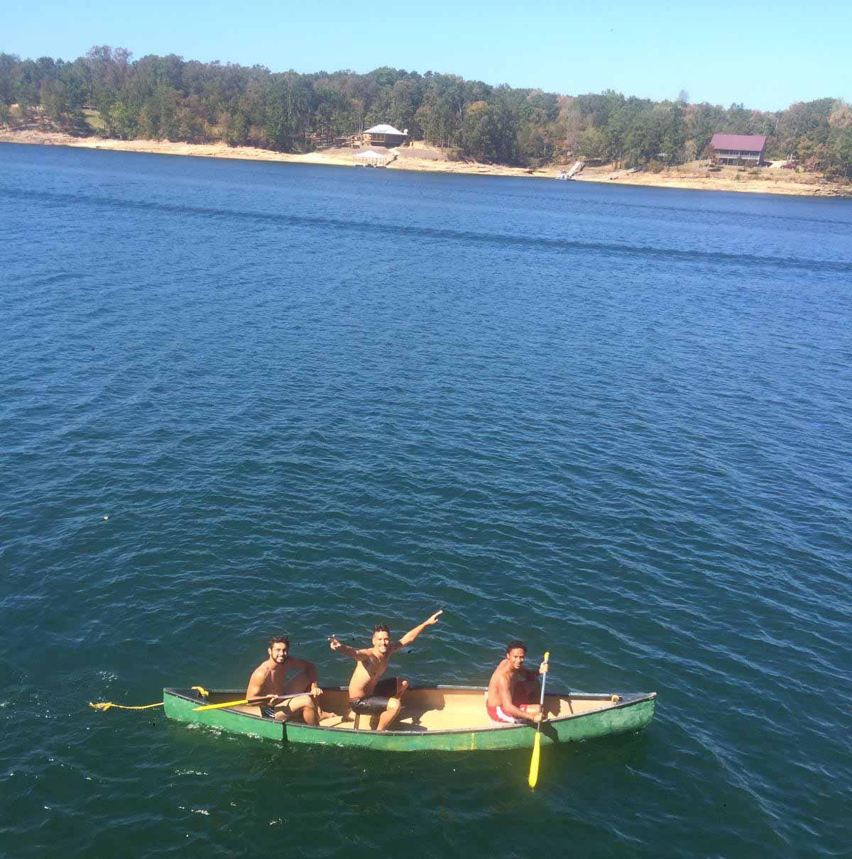 Men's Soccer on canoe in Smith Lake