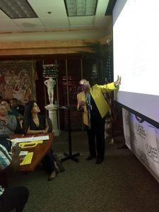 MSN program director Dr. Cesar points at projection screen while giving a presentation