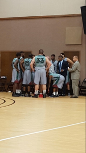 The Florida NationalUniversity Men's Basketball team huddle during a timeout.