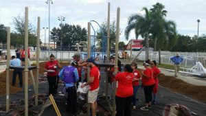 FNU Team members help build a playground
