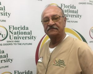Ricardo Sanchez poses in front of FNU logo