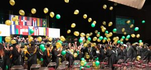 Graduation Ceremony with Balloons Falling