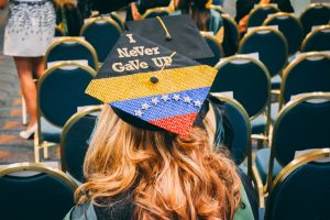 graduation cap on student decorated with Venezuelan flag