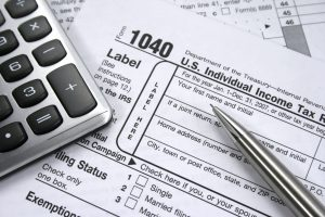 Calculator and 1040 Tax Form for Tax Season - Florida National University VITA IRS