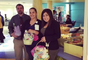 FNU Student Services Staff donates Easter Book Baskets to Nicklaus Childrens Hospital