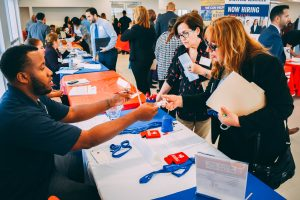Exchanging business cards at FNU Job Fair
