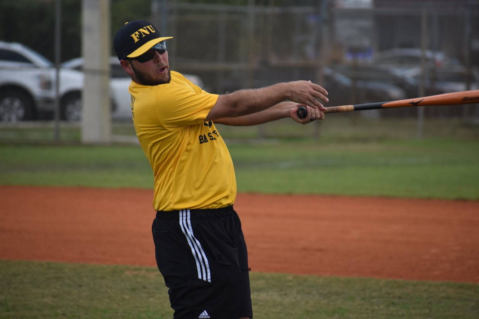 Coach Alfredo Carrillo Batting the ball