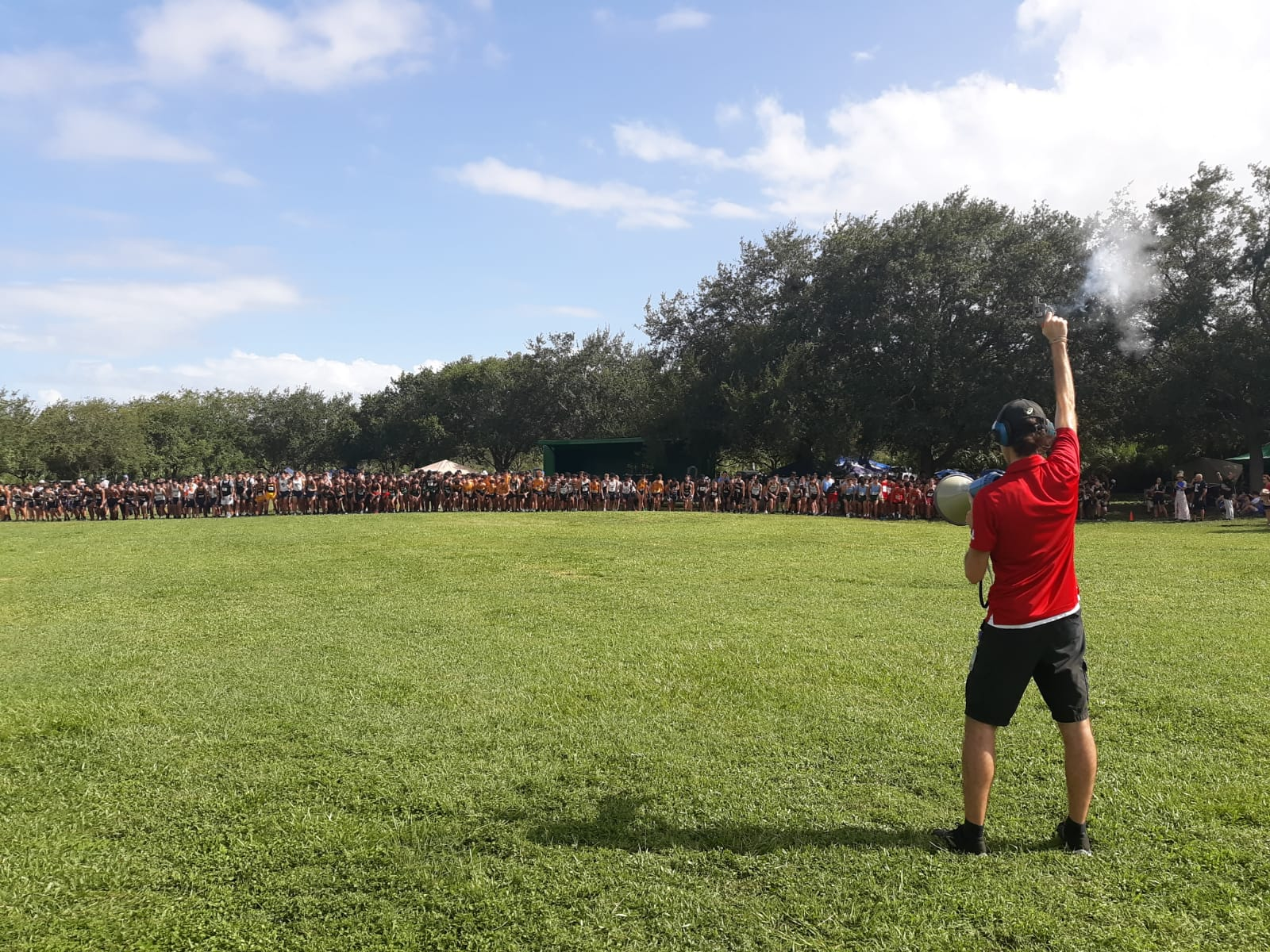 Cross Country Head Coach Ryan Raposo starting the Cross Country meet