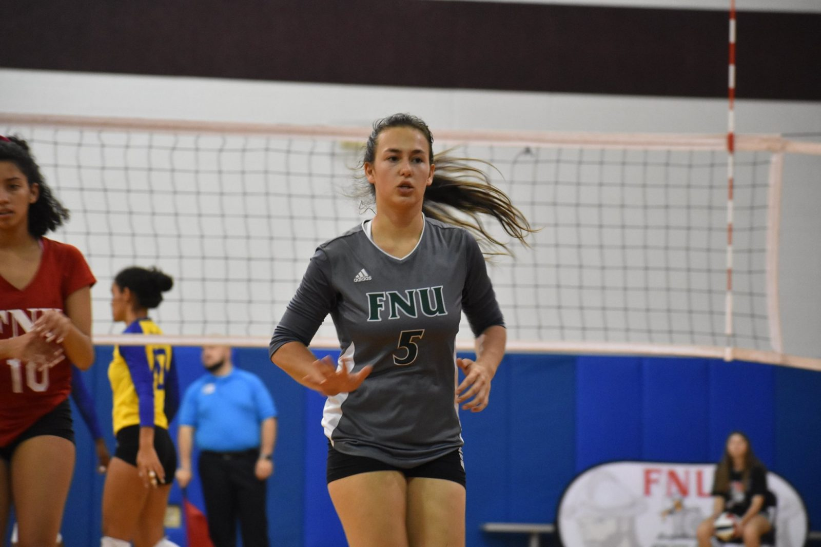 FNU Volleyball Player in the court celebrating