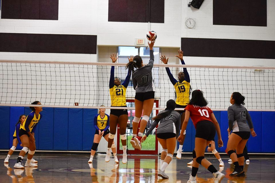 FNU volleyball player attacking in the game against Johnson and wales university