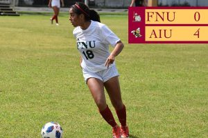 FNU Women's soccer player dribbling the ball the score show FNU 4 AIU 0
