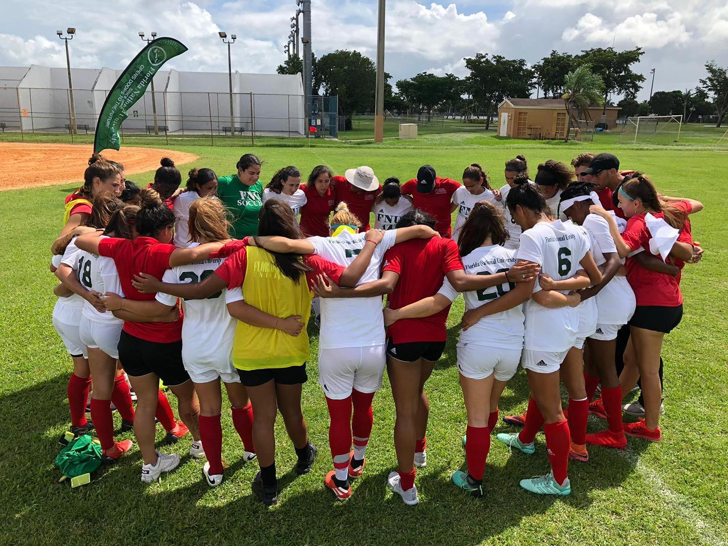 FNU Women's soccer team huddling up in a circle