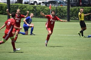FNU men's soccer team celebrating a goal