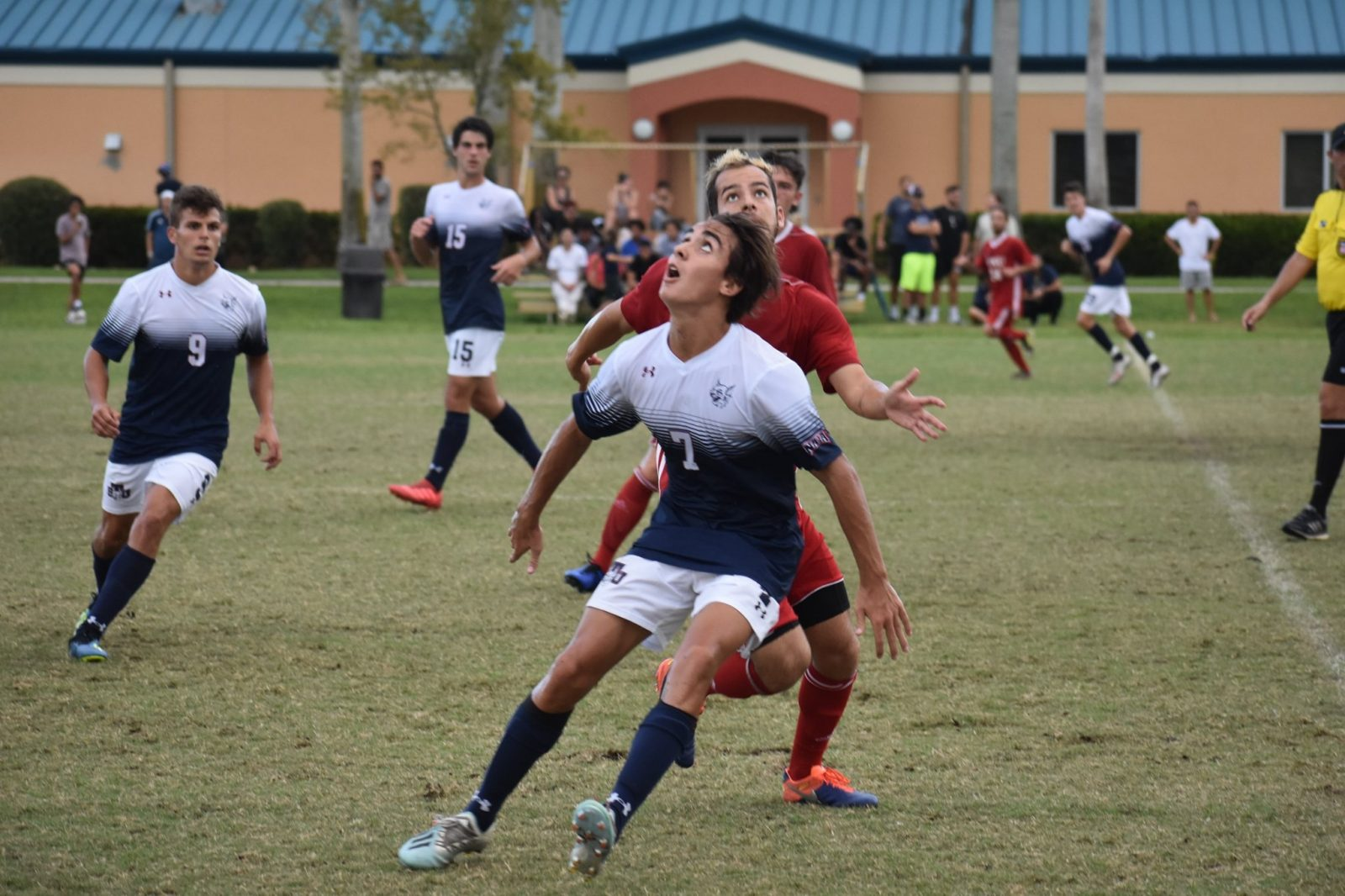 Florida National University player fighting for the ball during the soccer game
