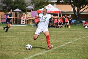 Fnu soccer player shooting the ball during the game against Warner University
