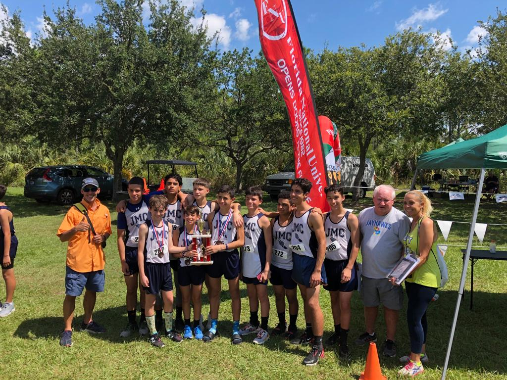 Team Receiving a trophy on the Cross Country meet