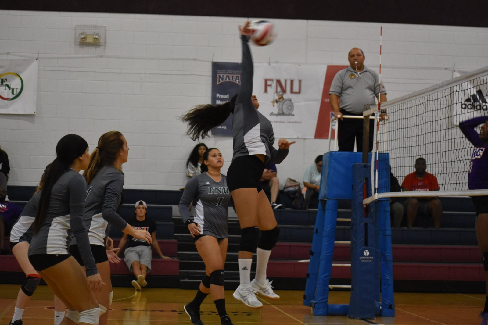 FNU Volleyball Player Attacking the ball during the game