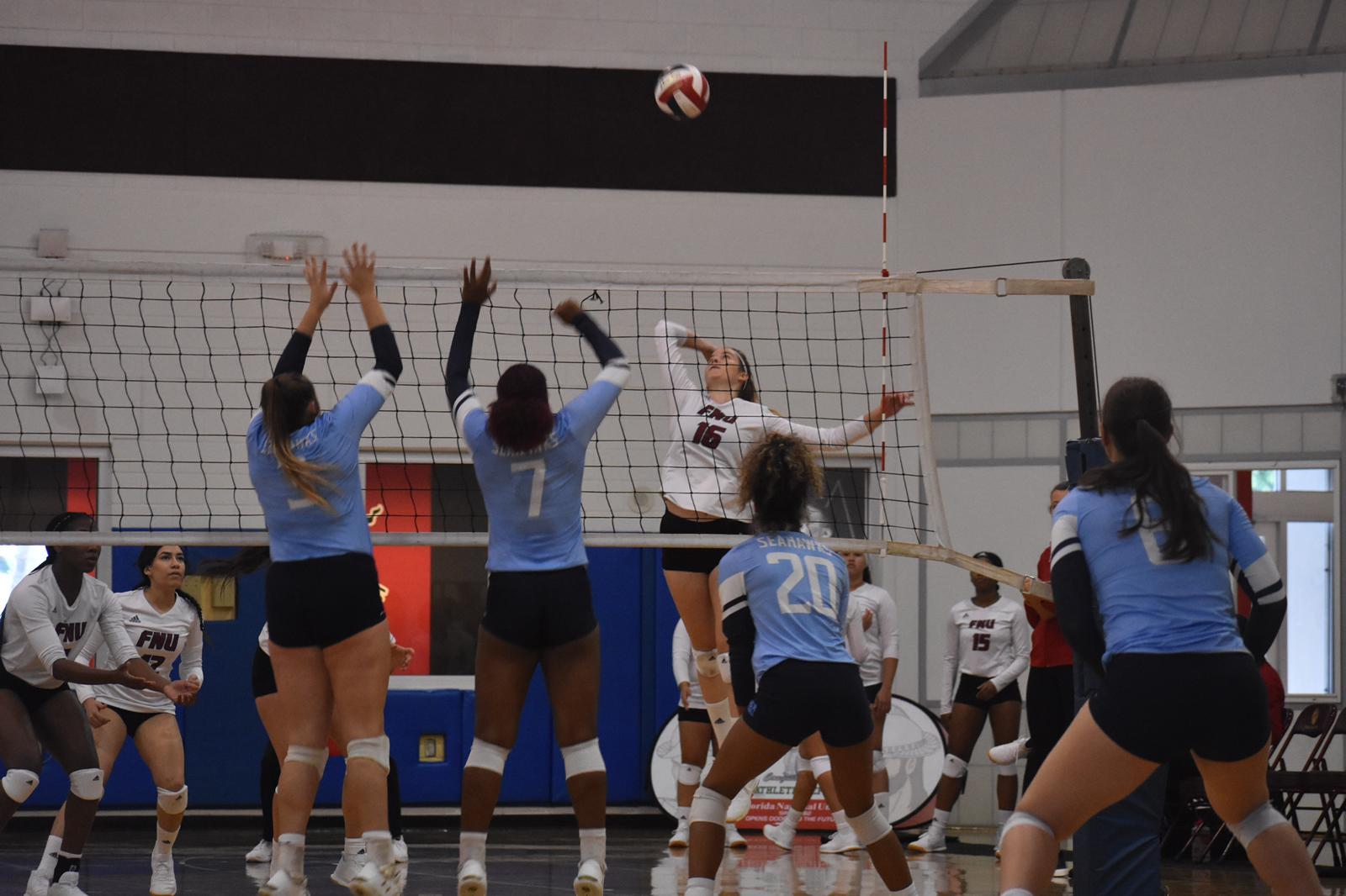 FNU Volleyball player attacking the ball
