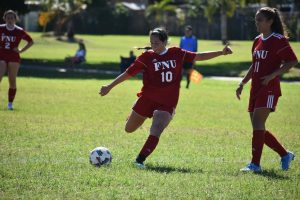 FNU soccer player Juliana Oliveira Shooting the ball