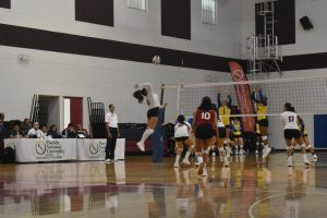 Fnu Volleyball Player Attacking the ball and opponents trying to block